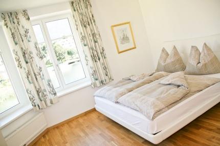 Seevilla Cattina – Schlafzimmer im Appartement Wasserlilie – Luxus-Appartements direkt am Millstätter See in Kärnten