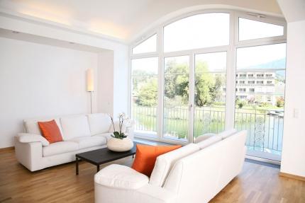 Seevilla Cattina – Wohnzimmer im Appartement Wasserlilie – Luxus-Appartements direkt am Millstätter See in Kärnten